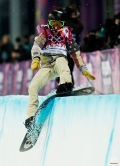 Shaun White, of the United States, hits the edge of the half pipe during the men's snowboard halfpipe final at the Rosa Khutor Extreme Park, at the 2014 Winter Olympics, Tuesday, Feb. 11, 2014, in Krasnaya Polyana, Russia. (AP Photo/Andy Wong)