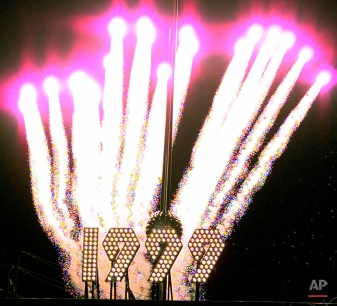 Fireworks erupt behind the ball drop to mark the New Year in Times Square Friday, Jan. 1, 1999, in New York. (AP Photo/Mark Lennihan)