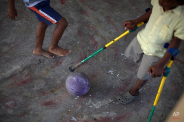 Sebastian Lamoth, 8, right, plays at his home with his cousin Joseph Rood in Port-au-Prince, Haiti, Monday Jan. 10, 2011. Lamoth's leg was amputated due to an injury suffered in the Jan. 12, 2010 earthquake. (AP Photo/Ramon Espinosa)