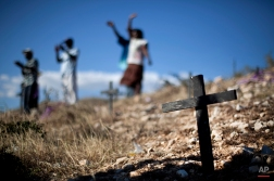 Relatives of those who died in the 2010 earthquake attend a memorial service at the mass grave site in Titanyen, on the outskirts of Port-au-Prince, Haiti, Thursday Jan. 12, 2012. Haitians are marking the second anniversary of the devastating 2010 earthquake with church services throughout the country on what is a national holiday of remembrance. (AP Photo/Ramon Espinosa)