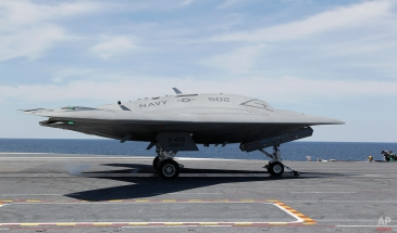 A Navy X-47B drone is launched off the nuclear powered aircraft carrier USS George H. W. Bush off the coast of Virginia, Tuesday, May 14, 2013. It was the Navy's first test flight of the unmanned aircraft off a carrier. (AP Photo/Steve Helber)
