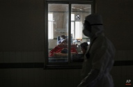 An Indian man suspected to be infected with swine flu rests while taking treatment inside the Swine flu ward at Gandhi Hospital in Hyderabad, India, Wednesday, Jan. 21, 2015. According to local reports, nine people died of the flu at the state-run hospital. (AP Photo/Mahesh Kumar A.)