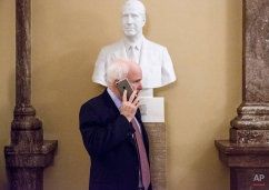 Senate Armed Services Committee Chairman Sen. John McCain, R-Ariz makes a cell phone call beneath a bust of former Vice President Spiro Agnew just off the Senate floor, Tuesday, Jan. 13, 2015, on Capitol Hill in Washington. (AP Photo/J. Scott Applewhite)