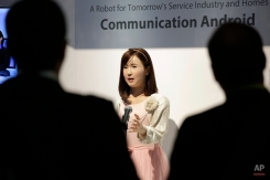 A robot named ChihiraAico interacts with attendees at the Toshiba booth at the International CES Wednesday, Jan. 7, 2015, in Las Vegas. (AP Photo/Jae C. Hong)