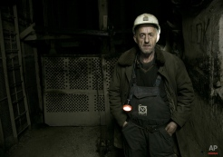 Miner of the Trepca mining complex stands inside of the Stari trg mine during a miners strike on Wednesday, Jan. 21, 2015. Over 400 employees have gone on strike inside the Trepca mine in Kosovo demanding the government takes over the administration of the Yugoslav-era giant complex to stop it from liquidation. Trepca spokesman Musa Mustafa said the workers want the government in charge of the complex, which is rich in lead, zinc, silver and gold. On Tuesday Kosovo's assembly amended a law on public enterprises which enabled it to delay resolving the Trepca issue for another 18 months. Serbia, that rejects Kosovo's 2008 secession, says no action can be taken without Belgrade's consent. (AP Photo/Visar Kryeziu)