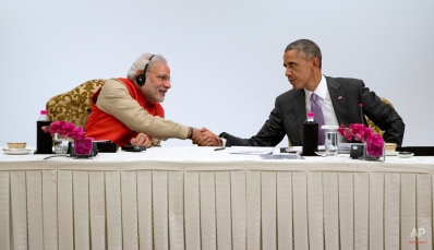 U.S President Barack Obama, right, shakes hands with Indian Prime Minister Narendra Modi as they participate in a CEO roundtable discussion at the The Taj Mahal Hotel in New Delhi, India, Monday, Jan. 26, 2015. Officials in both countries say Obama and Modi developed an easy chemistry when they first met in Washington last fall. The two leaders spent several hours together Sunday and heralded their close relationship. (AP Photo/Carolyn Kaster)