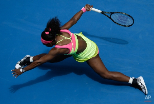 Serena Williams of the U.S. stretches out for a shot to Garbine Muguruza of Spain during their fourth round match at the Australian Open tennis championship in Melbourne, Australia, Monday, Jan. 26, 2015. (AP Photo/Bernat Armangue)