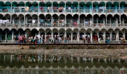 Bangladeshi students of an Islamic education school bathe in front of a polluted canal by their campus building in Kachpur, near Dhaka, Bangladesh, Tuesday, Jan. 6, 2015. (AP Photo/ A.M. Ahad)