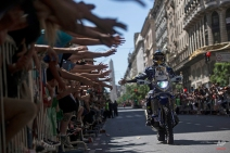 Yamaha rider Bruno da Costa of France greets spectators as he arrives for the symbolic start of the Dakar Rally 2015 in Buenos Aires, Argentina, Saturday, Jan. 3, 2015. The race will start on Jan. 4 and finish on Jan. 17, from Buenos Aires, passing through Bolivia and Chile and returning to Argentina. (AP Photo/Felipe Dana)