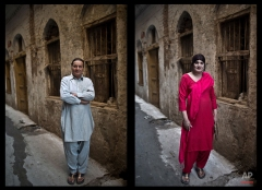 This combination of two images taken between Thursday, Jan. 8, 2015 and Friday, Jan. 9, 2015, shows Pakistani Bakhtawar Ijaz, 43, posing for a picture in an alley of a neighborhood in Rawalpindi, Pakistan. (AP Photo/Muhammed Muheisen)