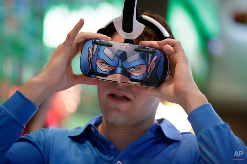 A brand ambassador tests Samsung's Gear VR headset at the Samsung Galaxy booth at the International CES Tuesday, Jan. 6, 2015, in Las Vegas. (AP Photo/Jae C. Hong)