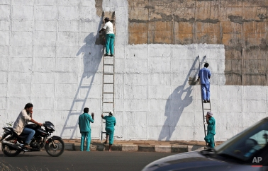 Indian prisoners paint a wall of Chanchalguda Central Jail in Hyderabad, India, Tuesday, Jan. 6, 2015. Chanchalguda Central Jail is one of the oldest prisons that was built in 1879 in the southern state of India. (AP Photo/Mahesh Kumar A.)
