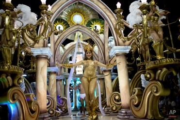 A dancer from the Ara Yevi samba school poses for a picture on a float representing the Vatican during carnival celebrations in Gualeguaychu, Argentina, Sunday, Jan. 11, 2015. (AP Photo/Natacha Pisarenko)