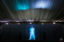 A life-size portrait of Pope Francis is lit at the entrance of the media tent outside the Manila Hotel in Manila, Philippines, Wednesday, Jan. 14, 2015. Pope Francis arrives Thursday from Sri Lanka for a pastoral visit which is expected to draw millions of faithful where about 81-percent of the population is Catholic. (AP Photo/Wally Santana)