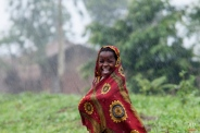 A Malawian school child smiles as she walks in the rain in Chiradzulou, southern Malawi, Thursday, Jan. 22, 2015. Malawi has been affected by flooding caused by heavy rains, with scores of people having died and some 200,000 displaced. (AP Photo/Shiraaz Mohamed)