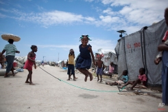 A young girl jumps rope inside the Jean-Marie Vincent camp for people displaced by the 2010 earthquake in Port-au-Prince, Haiti, Monday, April 22, 2013. (AP Photo/Dieu Nalio Chery)