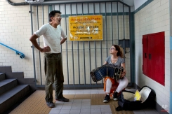 Jose Fister, 60, sings a tango as a street musician accompanies him with a bandoneon, in the entrance of a subway station in Buenos Aires, Argentina, Friday, Jan. 16, 2015. (AP Photo/Rodrigo Abd)