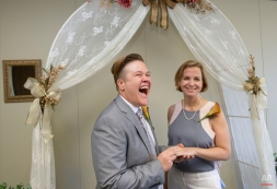 Rebekah Monson, left, 34, and her partner of nine years, Andrea Vigil, right, 37, share a laugh during their wedding ceremony at the marriage license bureau, Tuesday, Jan. 6, 2015, in Miami. Miami-Dade Circuit Judge Sarah Zabel presided over Florida's first legally recognized same-sex marriages Monday afternoon. Still, most counties held off on official ceremonies until early Tuesday, when U.S. District Judge Robert L. Hinkle's ruling that Florida's same-sex marriage ban is unconstitutional took effect in all 67 counties. (AP Photo/Wilfredo Lee)