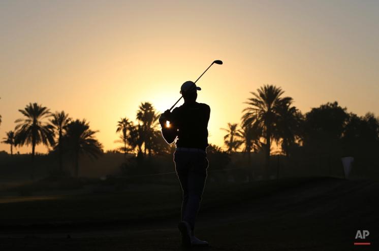 Seve Benson of England plays a shot on the 10th hole during the round two of the Dubai Desert Classic golf tournament in Dubai, United Arab Emirates, Friday, Jan. 30, 2015. (AP Photo/Kamran Jebreili)