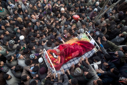 Kashmiri Muslim villagers carry the body of Ishfaq Ahmed Malik, a suspected local militant during his funeral procession in Arwani, some 55 kilometers (35 miles) south of Srinagar, India, Friday, Jan. 16, 2015. Indian soldiers and police killed five suspected rebels during a fierce gun battle Thursday in the disputed Himalayan region of Kashmir, officials said. (AP Photo/Dar Yasin)