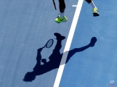 Roger Federer of Switzerland serves to Simone Bolelli of Italy during their second round match at the Australian Open tennis championship in Melbourne, Australia, Wednesday, Jan. 21, 2015. (AP Photo/Lee Jin-man)