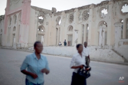 Haitians walk to Mass, past the ruins of the National Cathedral during the 5th anniversary of the January 2010 earthquake in Port-au-Prince, Haiti, Monday, Jan. 12, 2015. Somber Haitians gathered early Monday to remember the devastating earthquake that left much of the capital and surrounding area in ruins in one of the worst natural disasters of modern times. ( AP Photo/Dieu Nalio Chery)