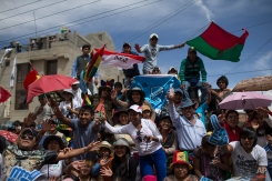 Spectators celebrate as competitors arrive at the seventh stage of the Dakar Rally 2015 between Iquique, Chile, and Uyuni, Bolivia, Saturday, Jan. 10, 2015. The race will finish on Jan. 17, passing through Bolivia and Chile before returning to Argentina where it started. (AP Photo/Felipe Dana)