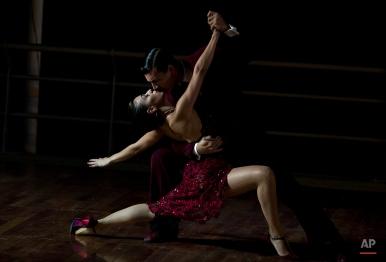 "A couple dances tango in La Boca neighborhood of Buenos Aires, Argentina, late Saturday, Jan. 24, 2015. The performance, coined ""La vida es una milonga,"" or Life is a Milonga, was organized by artist Cai Guo-Qiang. (AP Photo/Ivan Fernandez)"