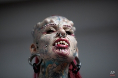 Mary Jose Cristerna, a Mexican known as The Vampire Woman, poses for the public to take portraits of her during the annual Venezuela Tattoo International Expo in Caracas, Venezuela, Thursday, Jan. 29, 2015. Tattoo artists from around the world are gathering for the four-day event that also includes under the skin implants and body piercing. (AP Photo/Ariana Cubillos)