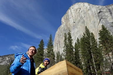 Tommy Caldwell, left, gestures beside fellow climber Kevin Jorgeson during a news conference Thursday, Jan. 15, 2015, in El Capitan meadow in Yosemite National Park, Calif. The two climbers became the first in the world to use only their hands and feet to scale El Capitan, a sheer granite face in California's Yosemite National Park. (AP Photo/Ben Margot)