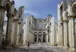 In this photo taken on Jan. 7, 2012, a youth walks inside the earthquake damaged Notre Dame De l'Assomption Cathedral in Port-au-Prince, Haiti. (AP Photo/Dieu Nalio Chery)