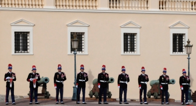 Monaco guards stand in front of Monaco palace during the St. Devote festivities, Tuesday, Jan. 27, 2015, in Monaco. Saint Devote is the patron saint of the Grimaldi family, reigning in Monaco, and every Jan. 27th, the Principality celebrates St. Devote's Day as a national holiday. (AP Photo/Lionel Cironneau)