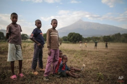 Tanzanian boys pose for a photo after a football game in Arusha, eastern Tanzania, Thursday, Jan. 15, 2015. The city is close to national parks, including Serengeti and Kilimanjaro. (AP Photo/Mosa'ab Elshamy)