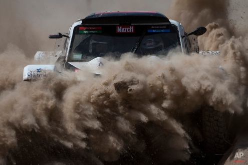 Buggy MD Rally driver Pascal Thomasse and co-pilot Pascal Larroque, both of France, race during the third stage of the Dakar Rally 2015 between the cities of San Juan and Chilecito, Argentina, Tuesday, Jan. 6, 2015. The race will finish on Jan. 17, passing through Bolivia and Chile and returning to Argentina. (AP Photo/Felipe Dana)
