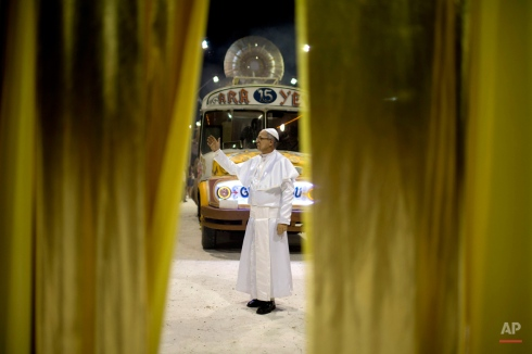 Roman Figun, a local lawyer, performs the role of Pope Francis with the Ara Yevi samba school during their carnival parade that pays tribute to the Argentine-born pontiff in Gualeguaychu, Argentina, Saturday, Jan. 10, 2015. (AP Photo/Natacha Pisarenko)