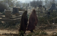 Pakistani women leave the Rahman Baba graveyard after offering prayers at the graves of victims in Tuesday's school massacre in Peshawar, Pakistan, Saturday, Dec. 20, 2014. (AP Photo/Mohammad Sajjad)