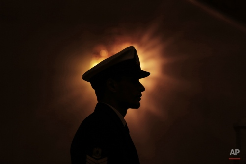 In this Friday, Jan. 9, 2015 photo, a Libyan honor guard stands at attention during the arrival of U.N. Special Envoy to Libya Bernardino Leon in Tripoli.(AP Photo/Mohammed Ben Khalifa)
