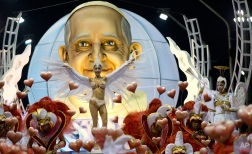 The Ara Yevi samba school performs with a float showcasing Pope Francis, their homage to the Argentine-born pontiff during carnival celebrations in Gualeguaychu, Argentina, early Sunday, Jan. 11, 2015. The group is performing with two other schools during the carnival that continues throughout Feb. 28. (AP Photo/Natacha Pisarenko)