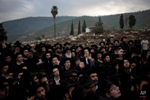 Orthodox Jewish men attend the funeral of Rabbi Mordechai Shmuel Ashkenazi, Chief Rabbi of Kfar Chabad in the old cemetery of Tiberia, near the sea of Galilee in northern Israel, Thursday, Jan. 15, 2015. Ashkenazi died at 71 on Wednesday. (AP Photo/Ariel Schalit)