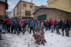 In this Monday, Jan. 19, 2015 picture, people throw turnips at the Jarramplas as he makes his way through the streets beating his drum during the Jarramplas Festival. (AP Photo/Daniel Ochoa de Olza)