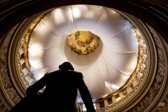 A statue of George Washington is seen under the Rotunda of the Capitol on Capitol Hill in Washington, Tuesday, Jan. 6, 2015, which is partially covered by a billowy, protective canvas to catch any debris during a long-term repair project to fix cracks, leaks and corrosion in the cast-iron dome during renovations, Tuesday, Jan. 6, 2015, on the start of the 114th Congress. (AP Photo/Jacquelyn Martin)