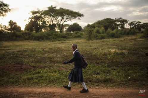 A Tanzanian girl smiles as she makes her way back from school in Arusha, eastern Tanzania, Thursday, Jan. 15, 2015. (AP Photo/Mosa'ab Elshamy)
