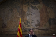 Catalonia's regional president Artur Mas gestures during a press conference announcing elections at the Generalitat Palace in Barcelona, Spain, Wednesday, Jan. 14, 2015. The leader of Spain's separatist-minded Catalonia region has announced that regional elections will be held in September to determine whether a majority of lawmakers favor an independence drive. Catalonia regional leader Artur Mas says elections will be held Sept. 27 after he failed last year to convince the central government in Madrid to allow the region to hold an independence referendum. (AP Photo/Emilio Morenatti)
