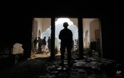 A Pakistan army soldier stands guard in the Army Public School, attacked Tuesday by Taliban militants, Thursday, Dec. 18, 2014 in Peshawar, Pakistan. (AP Photo/Mohammad Sajjad)