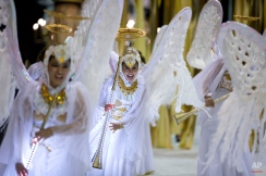 Ara Yevi samba school dancers dressed as angles sing and dance during a carnival parade in Gualeguaychu, Argentina, early Sunday, Jan. 11, 2015. The samba school paid tribute to the Pope Francis at the opening of the country's biggest carnival celebration. (AP Photo/Natacha Pisarenko)
