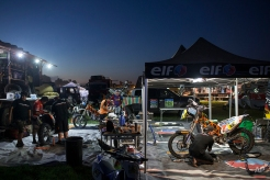 Mechanics work on motorcycles at the Dakar Rally 2015 camp before the start of the last stage between the cities of Rosario and Buenos Aires, Argentina, Friday, Jan. 16, 2015. (AP Photo/Felipe Dana)