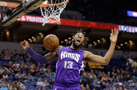 Sacramento Kings forward Derrick Williams (13) reacts after dunking against the Minnesota Timberwolves during the second quarter of an NBA basketball game in Minneapolis, Thursday, Jan. 1, 2015. (AP Photo/Ann Heisenfelt)