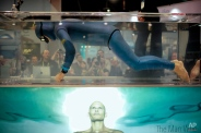Stig Severinsen, a Guinness World Record holder for holding his breath for 22 minutes, holds his breath in a water tank at the Masimo booth at the International CES Thursday, Jan. 8, 2015, in Las Vegas. (AP Photo/Jae C. Hong)