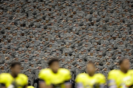 Members of the Army salute during the National Anthem prior to the U.S. Army All-American Bowl high school football game, Saturday, Jan. 3, 2015, in San Antonio. (AP Photo/Eric Gay)