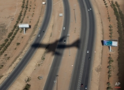 The shadow of Air Force One with President Barack Obama and first lady Michelle Obama, aboard is seen on arrival at King Khalid International Airport, in Riyadh, Saudi Arabia, Tuesday, Jan. 27, 2015. The president will meet with the new Saudi King, Salman bin Abdul Aziz to expresses his condolences on the death of the late Saudi Arabian King Abdullah bin Abdulaziz al-Saud. (AP Photo/Carolyn Kaster)